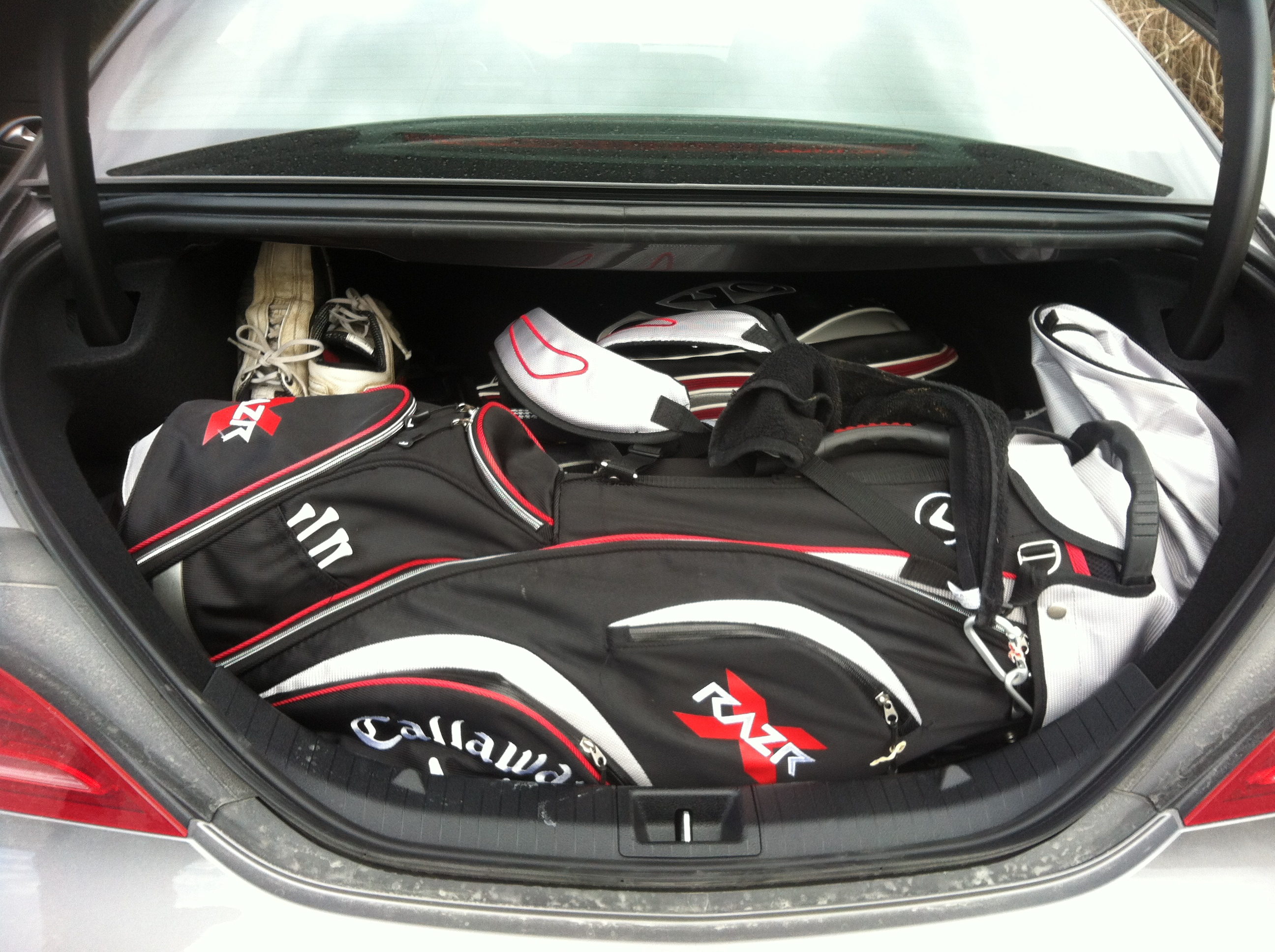 Can you fit golf clubs in a mercedes sl for Mercedes benz golf bag